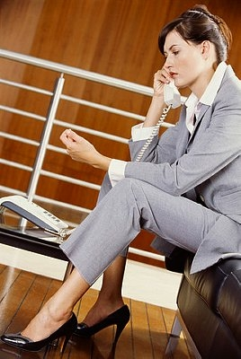 Tilted view of a businesswoman using a mobile phone